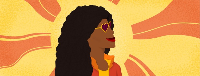 a woman with heart sunglasses smiling
