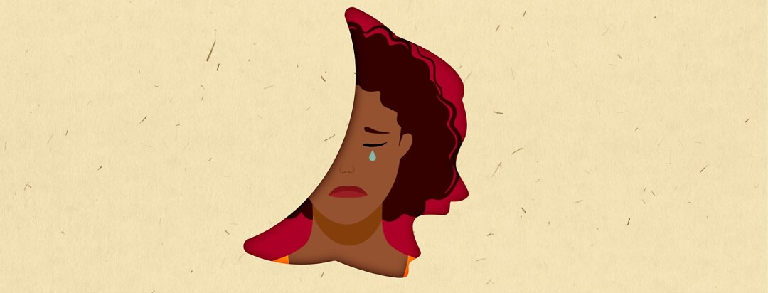A woman crying in the silhouette of a sickle cell