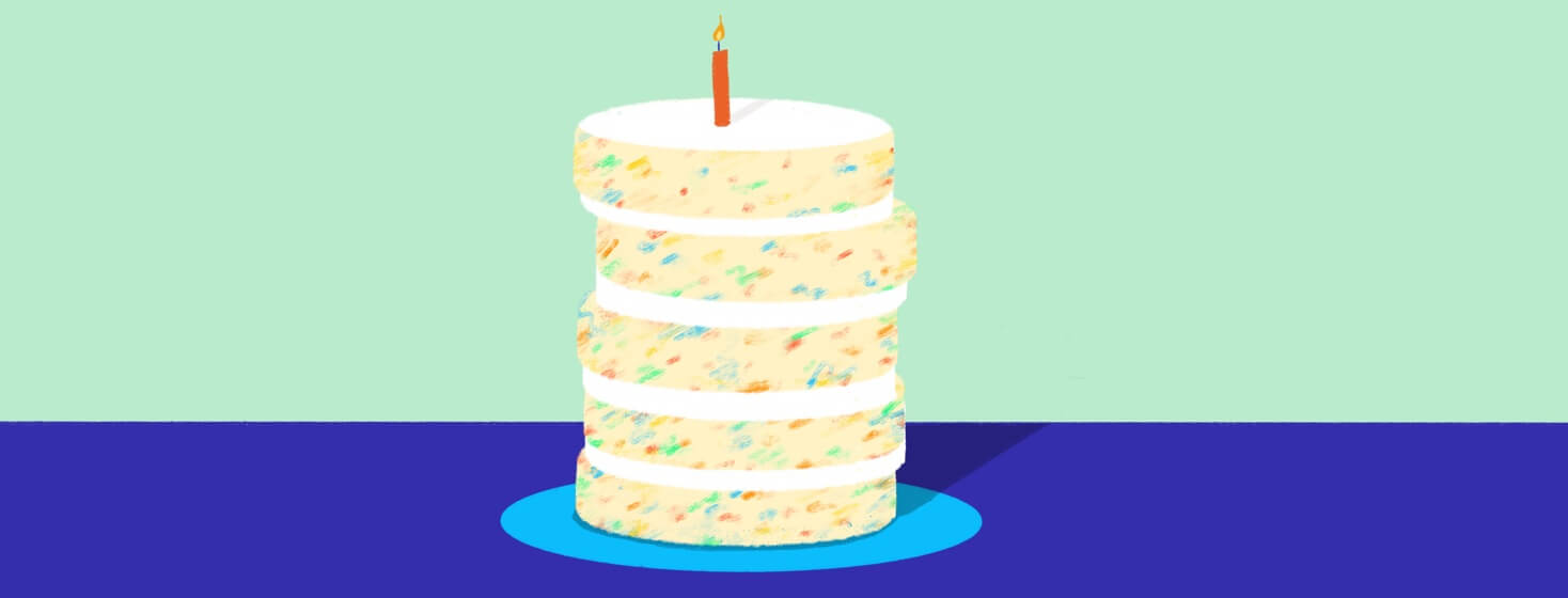 A slightly crooked tall multi-tier cake with a birthday candle.