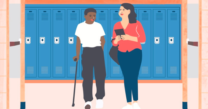 Two students in a classroom hallway one student has a cane